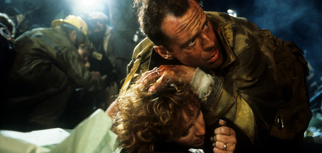 Bruce Willis (John McClane) şi Bonnie Bedelia (Holly Gennaro McClane) în Die Hard 1988