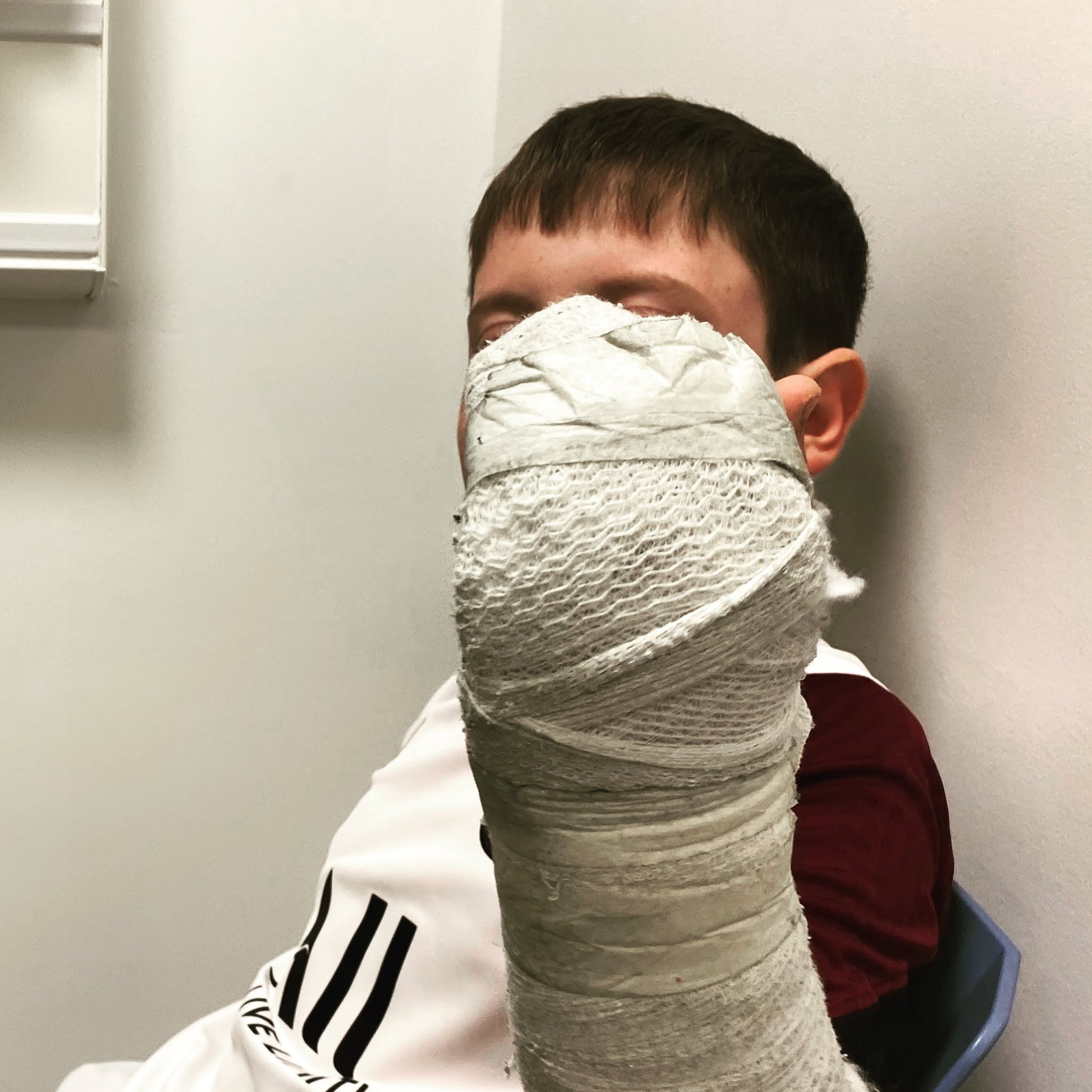 boy with a bandaged arm