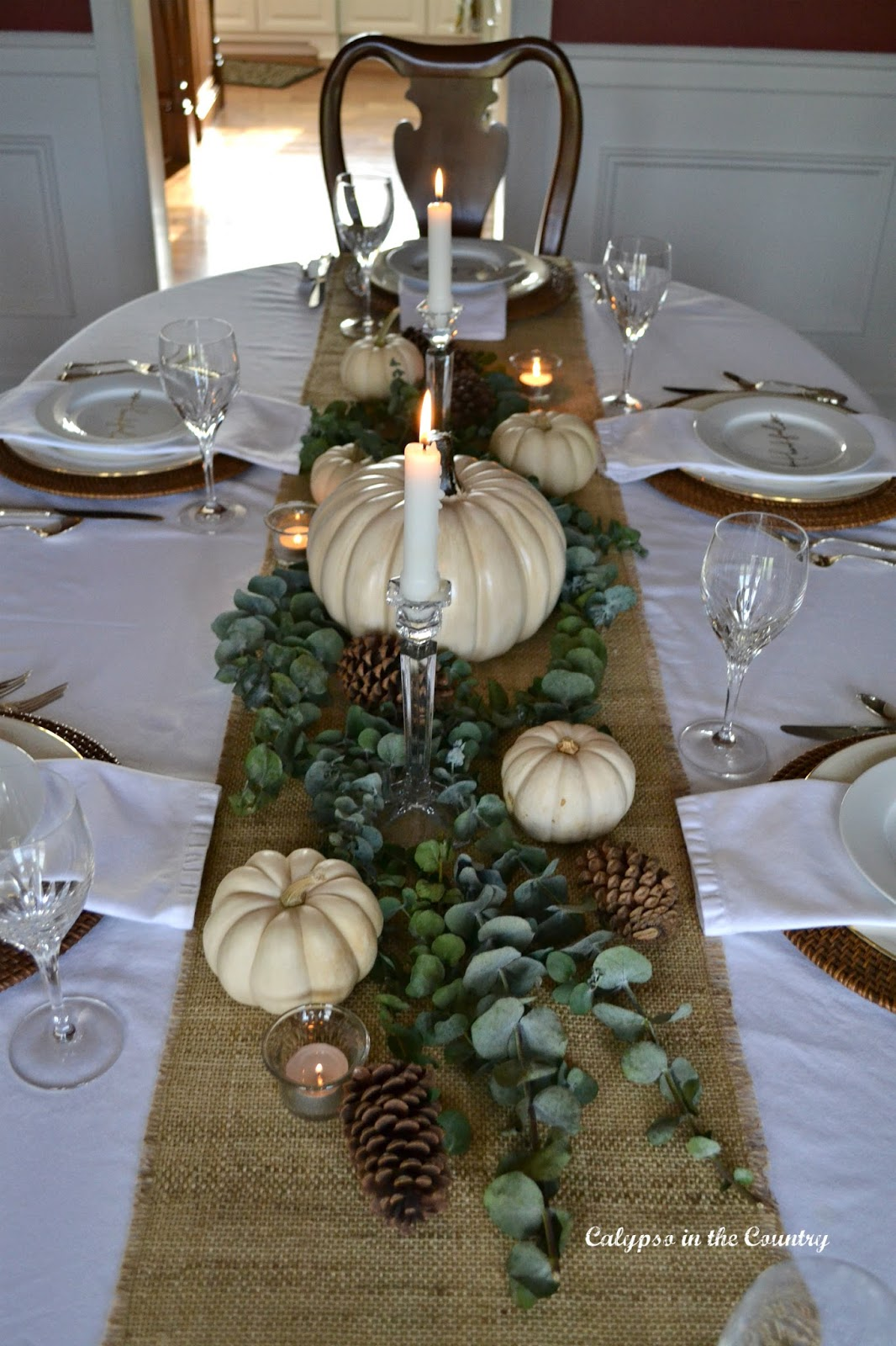 Table set with Burlap Runner and White Pumpkins