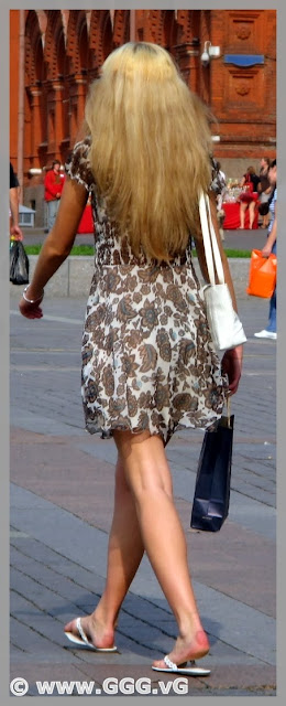 Lady wears summer dress on the street