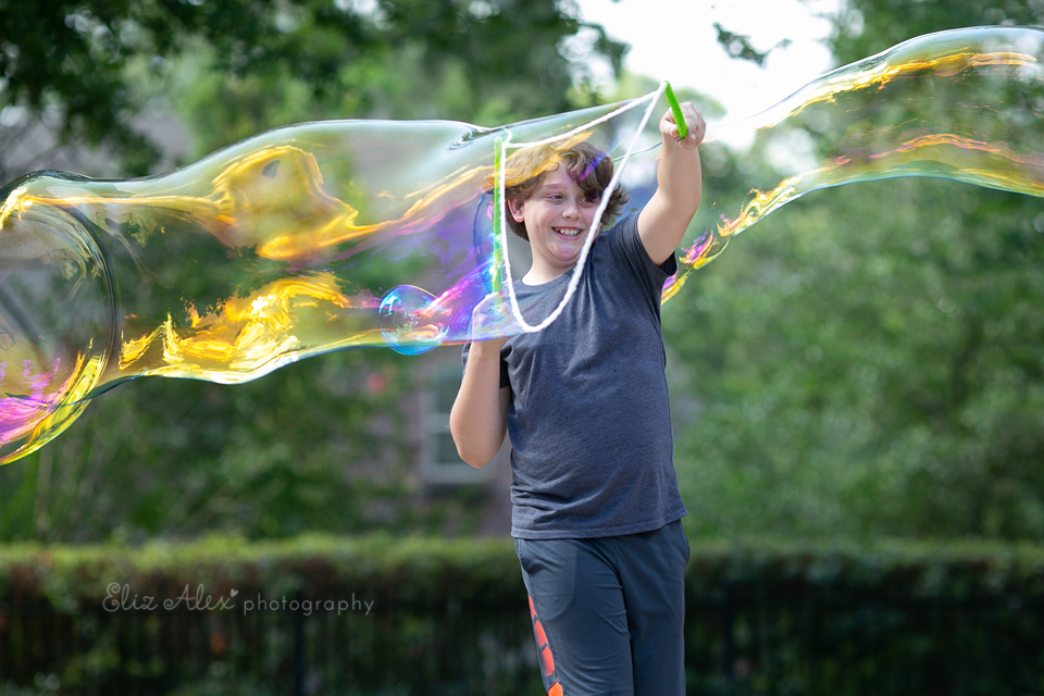 boy smiling giant bubbles woodlands texas