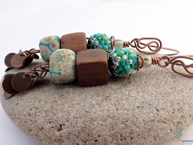 https://www.etsy.com/listing/210988004/elsa-beautiful-long-dangle-earrings-in?ga_search_query=earrings&ref=shop_items_search_45