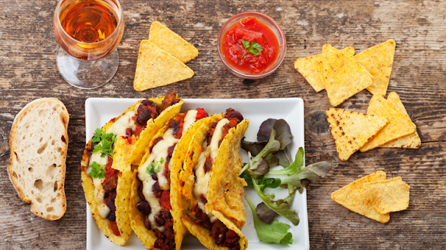 corn taco shells filled with Navajo Taco fillings