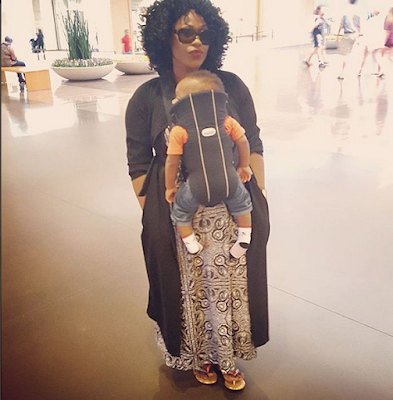 Uche Jumbo and her son venture out together in style