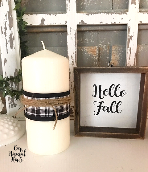 white pillar candle buffalo check ribbon twine