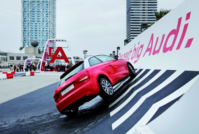 Red Audi car climbing on the wall