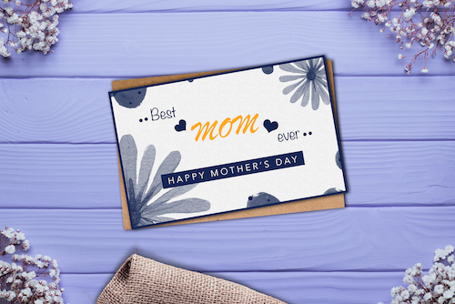 Mother's day card on purple wooden background