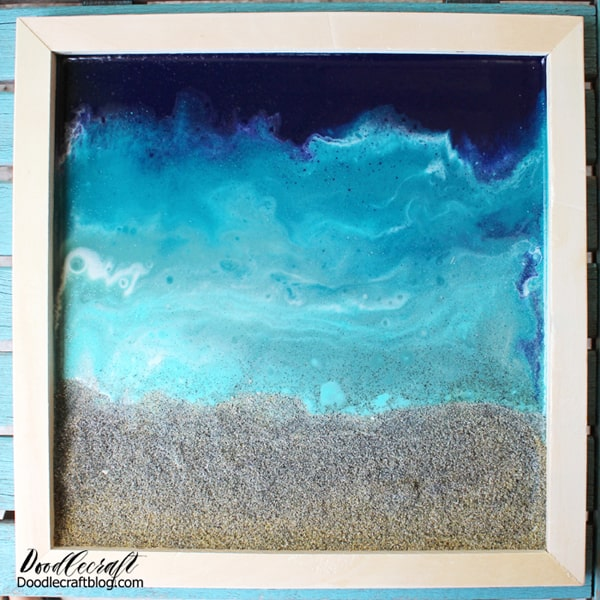 Use glossy resin to make the perfect ocean pour including a little beach sand. Great for beach-inspired home decor.