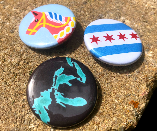Transit Tees Dala Horse, Great Lakes and Chicago Flag buttons produced here in Chicago!