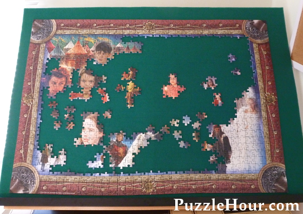 Working a jigsaw puzzle on a tilted surface with green poker fabric