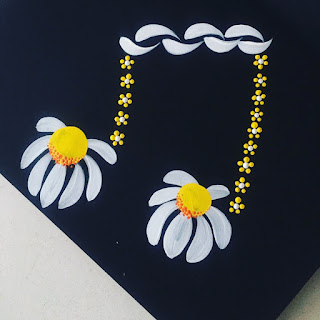 You Can Folk it's folk art daisies painted to create musical notes
