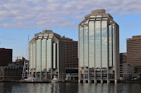 Reflection of clouds in a glass building in the Halifax Harbour