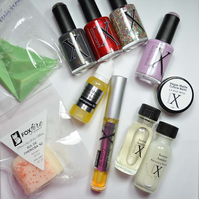 new wax melts, nail care products, and nail polish arranged in a flat lay