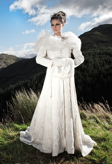 Pretty woman in a snow queen gown