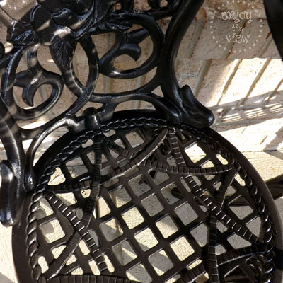 closeup of black wrought iron chair seat