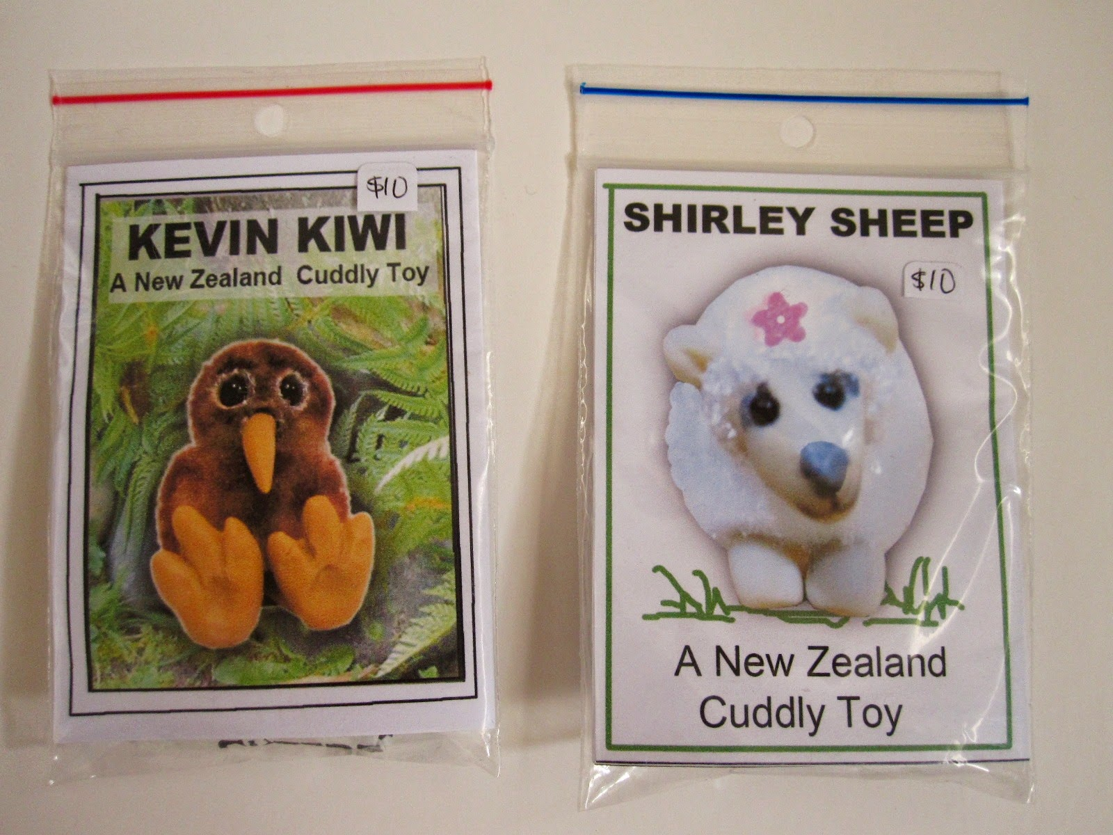 The fronts of two bagged miniature cuddly toy kits: Kevin Kiwi and Shirley Sheep.
