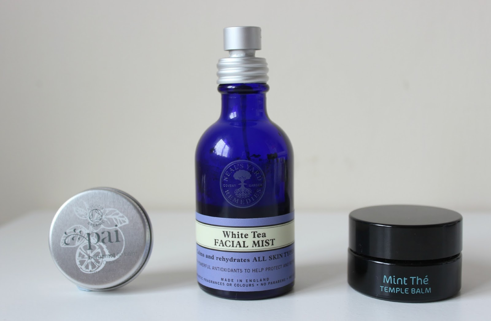 A picture of Pai Skincare Bergamot Lip Balm, Neal's Yard Remedies White Tea Facial Mist and Bodhi & Birch Mint The Temple Balm