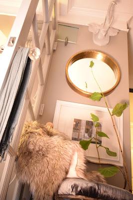 wall art pendant lighting fixtures, stone color faux fur;crystal door knobs; velvet upholstered chair;JoFer
