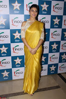 Gorgeous Jacqueline Fernandez  in yellow saree 03.JPG