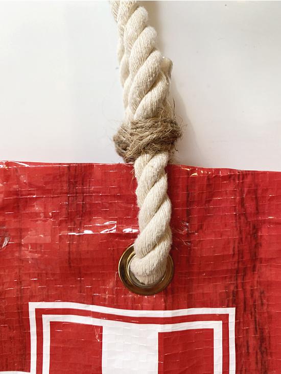rope through grommet in bag with jute tie