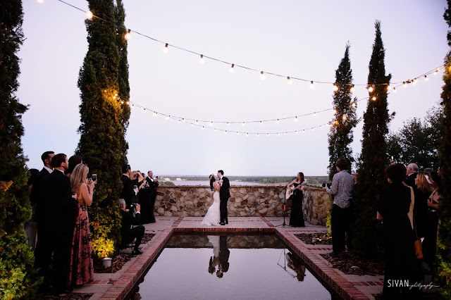 bride and groom first dance by reflection pool