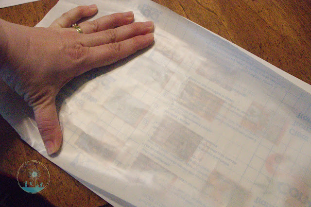 You can see the book covers under the contact paper which gives you an idea how much area to cover with your scratch-off paint.
