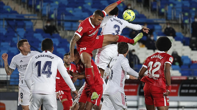 Real Madrid and Sevilla players battling for the ball
