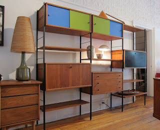 superb modular shelving unit plus bright lighting also wooden flooring and interior panel door