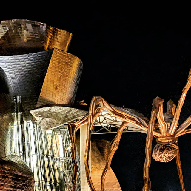 Why Bilbao is the Best Place in Spain for Christmas: Spider sculpture outside the Guggenheim Bilbao at night