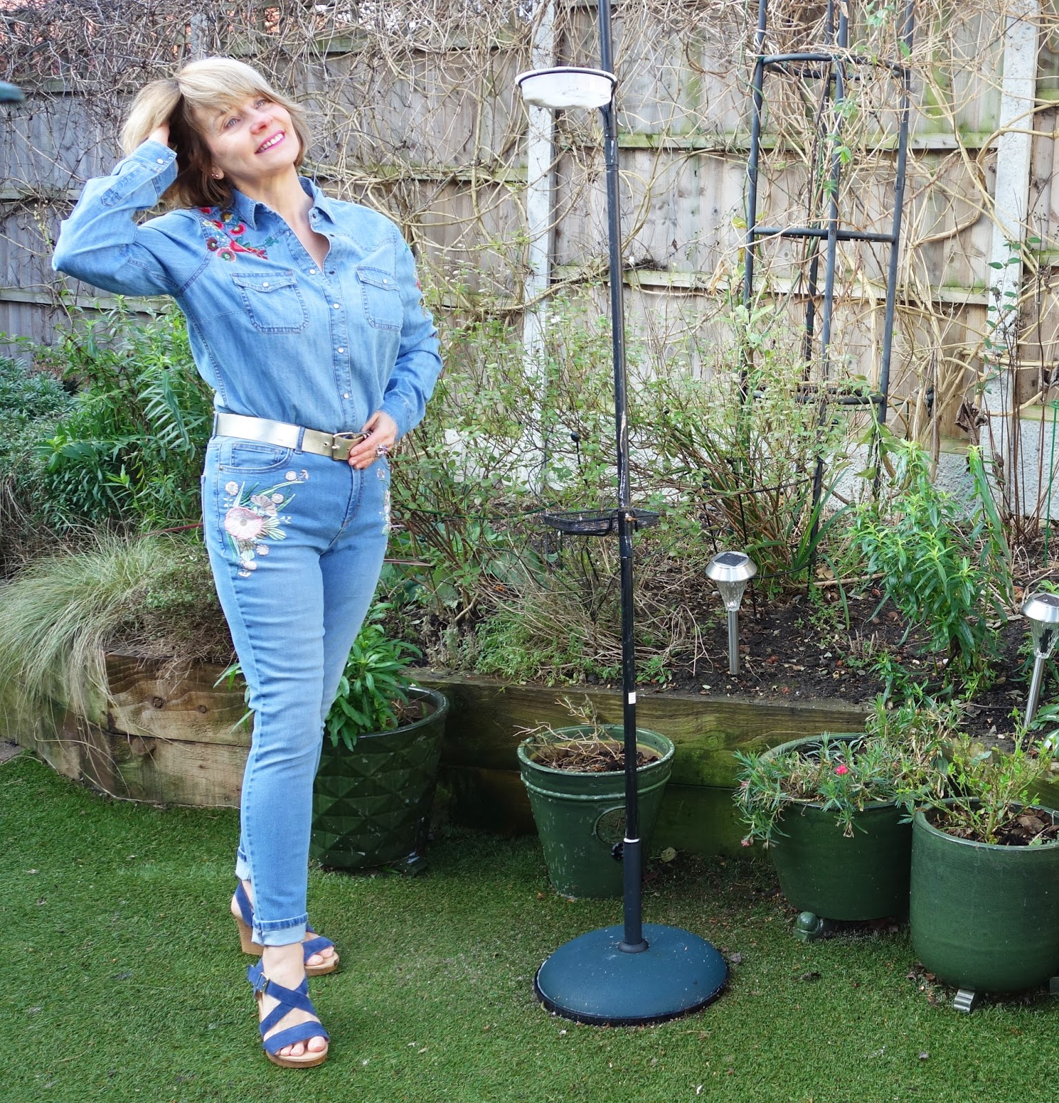 Double denim: embroidered jeans and embroidered shirt
