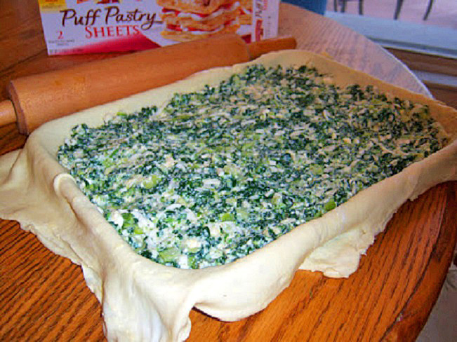 this is the spinach and broccoli filling poured into the puff pastry dough ready for baking