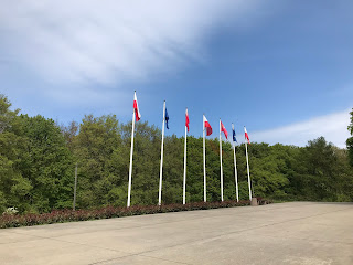 flags on tall poles underneath a blue sky