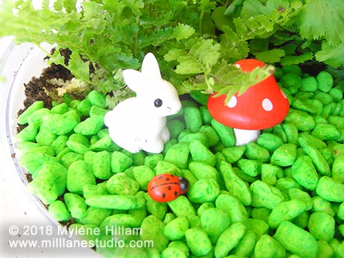 woodland creatures in a mini terrarium