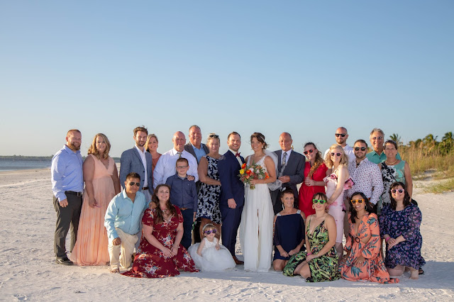 Large family photos at Fort Myers beach wedding.