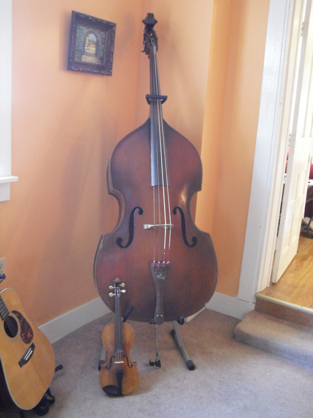 the big upright bass in our living room. Black Bedroom Furniture Sets. Home Design Ideas