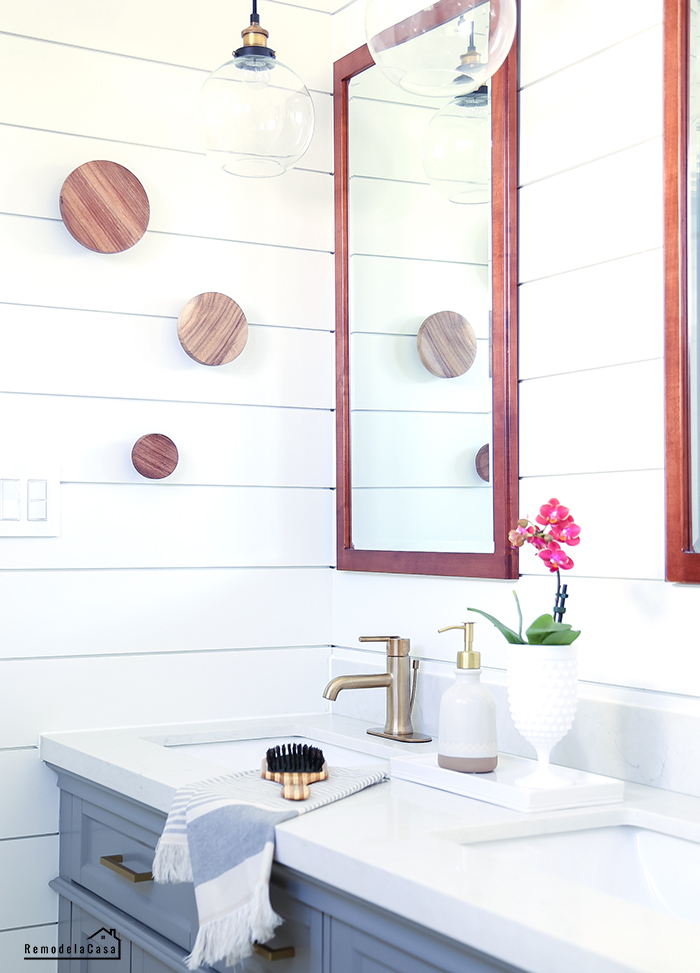 modern vintage bathroom with gray vanity and subway tile
