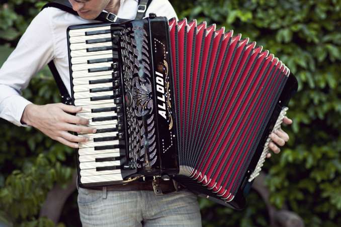Accordion musician Dave Thomas photographed by STUDIO 1208