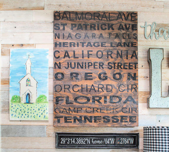 gallery wall with painted country church