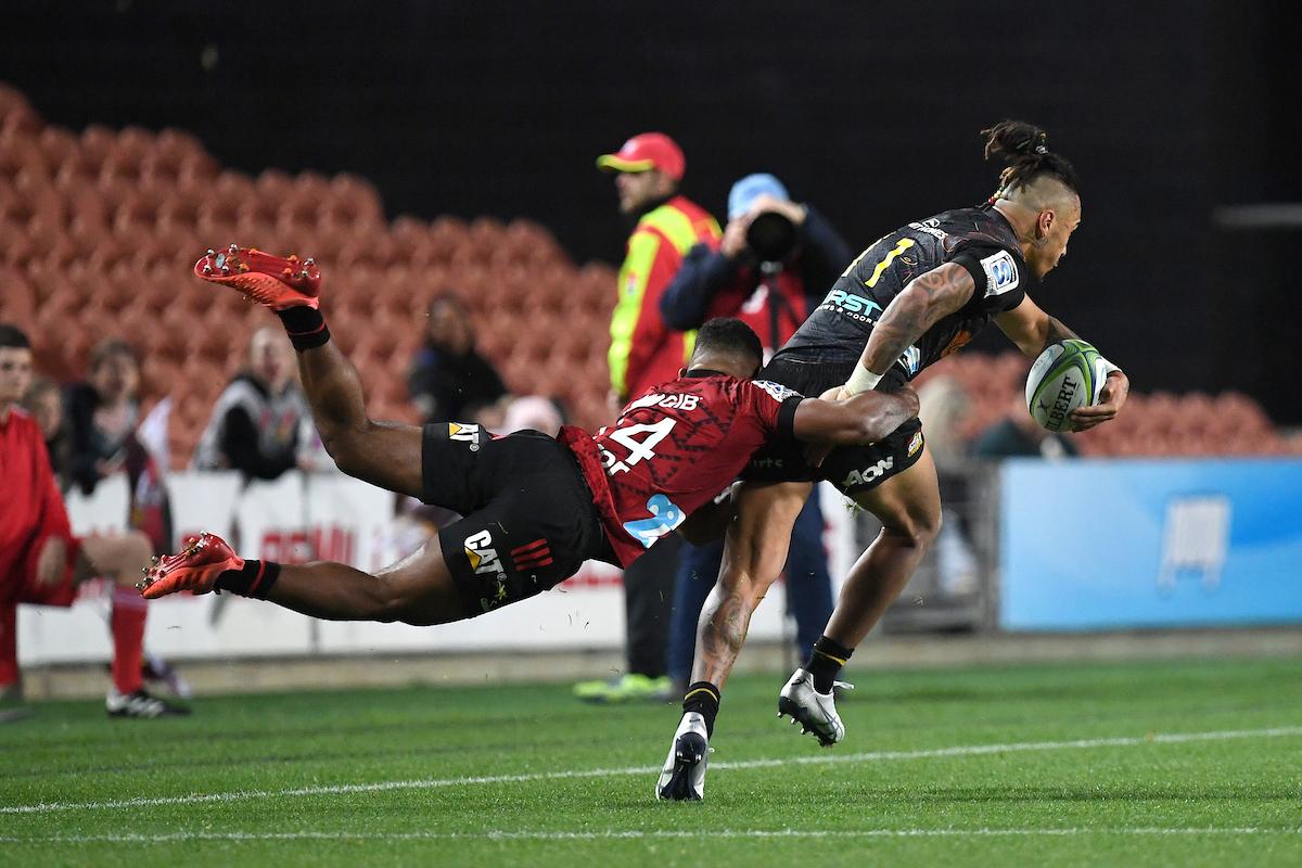 Sevu Reece tackles Sean Wainui