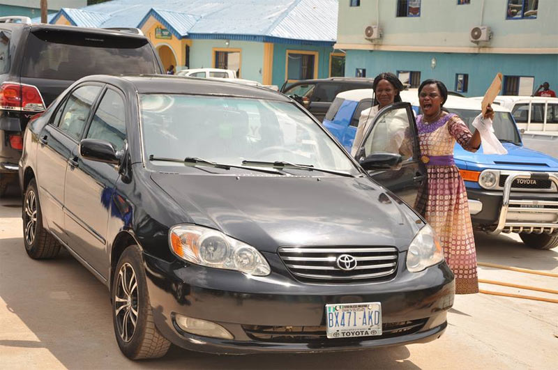 Apostle Suleman gifts car to female church member