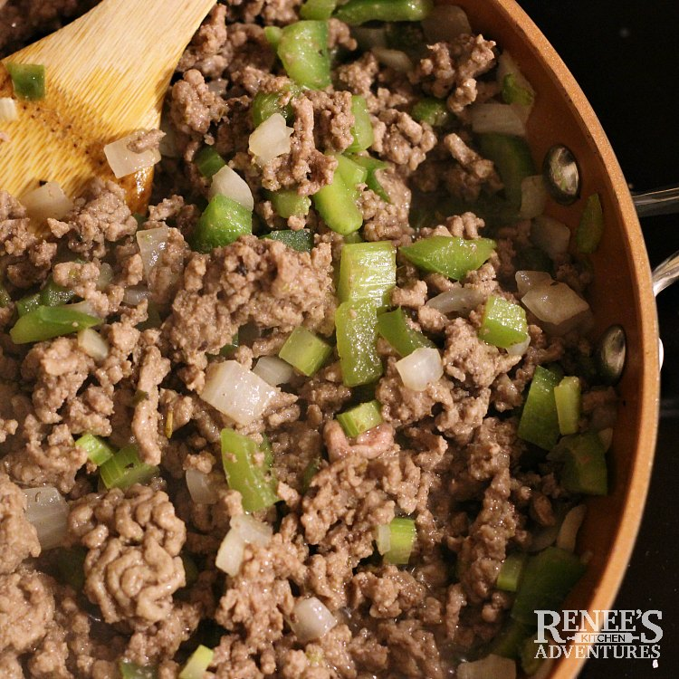 Process shot of Johnny Marzetti by Renee's Kitchen Adventures browning ground beef with vegetables in skillet