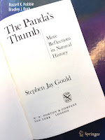 The Panda's Thumb, by Stephen Jay Gould, superimposed on Intermediate Physics for Medicine and Biology.