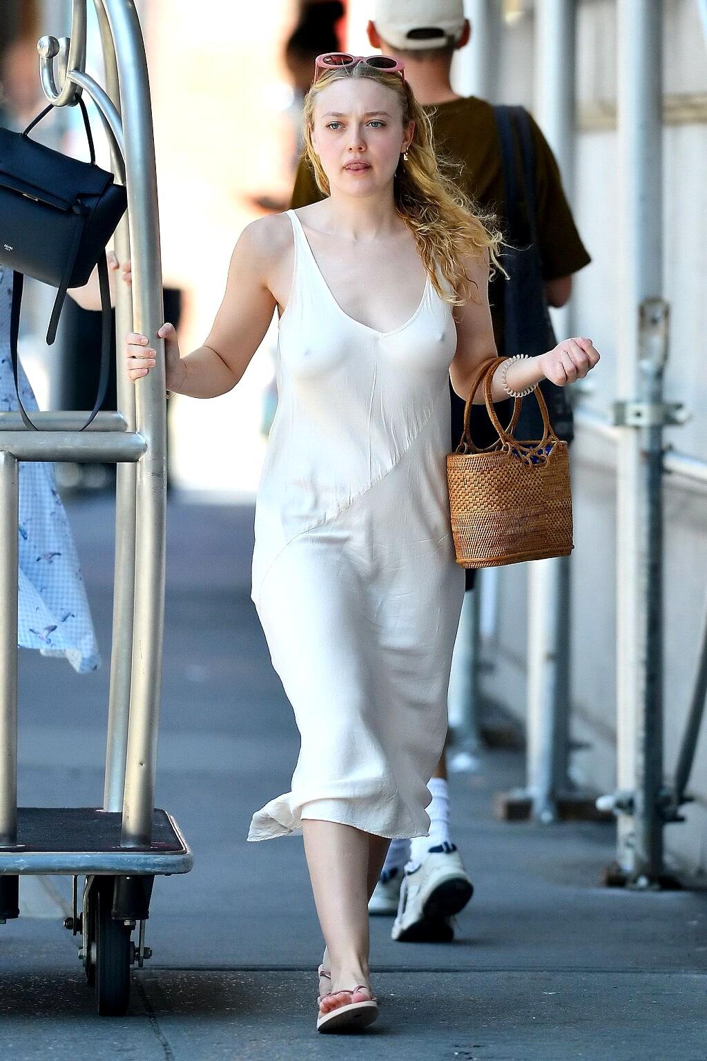 Dakota Fanning Looks Hot in White Dress