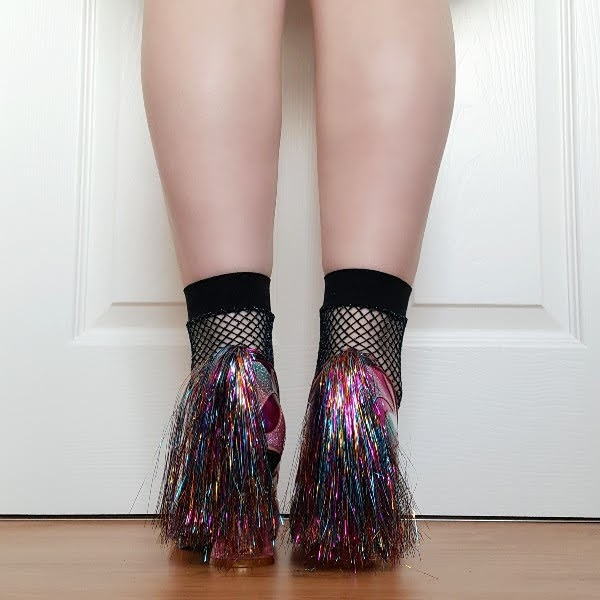 back view wearing multi coloured tinsel tailed zebra shoes