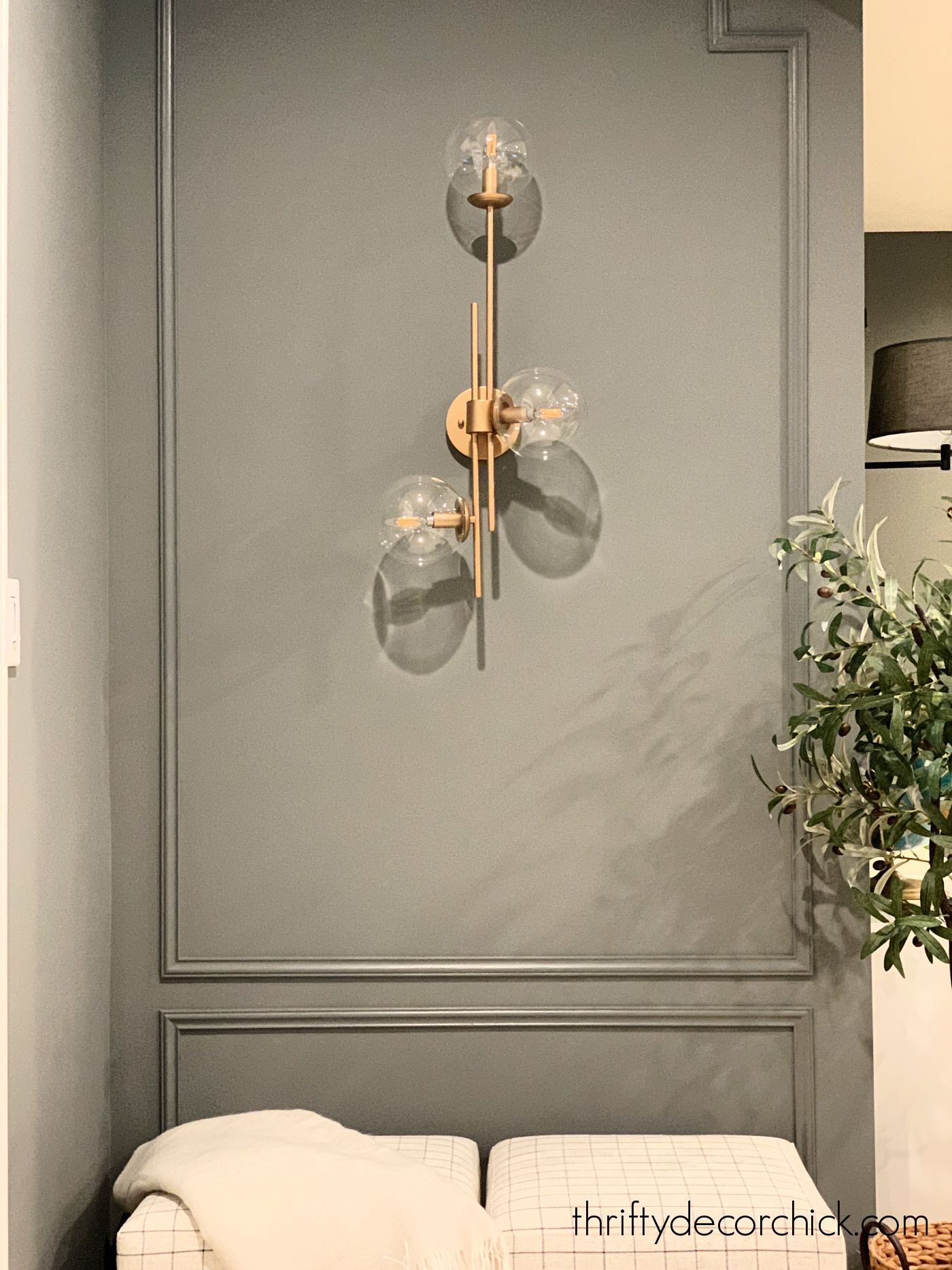 dressing up small wall with sconce and paint