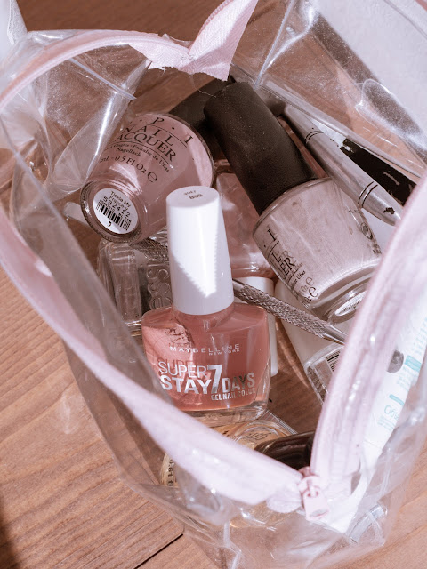 Neutral nail polishes in clear cosmetic pouch
