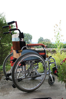 pimped manual wheelchair with striped fabric and painted sides