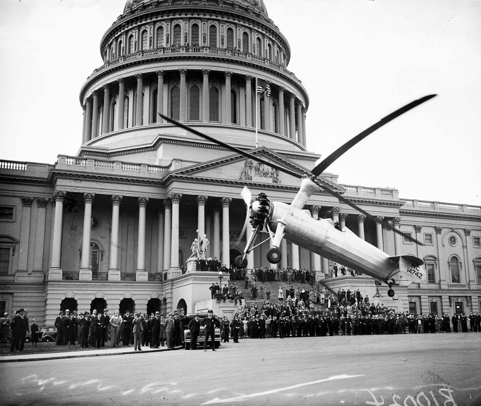 An autogyro takes off in front of the United States Capitol. 1936.