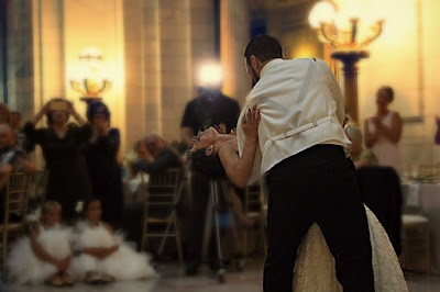 The married couple dancing at a wedding