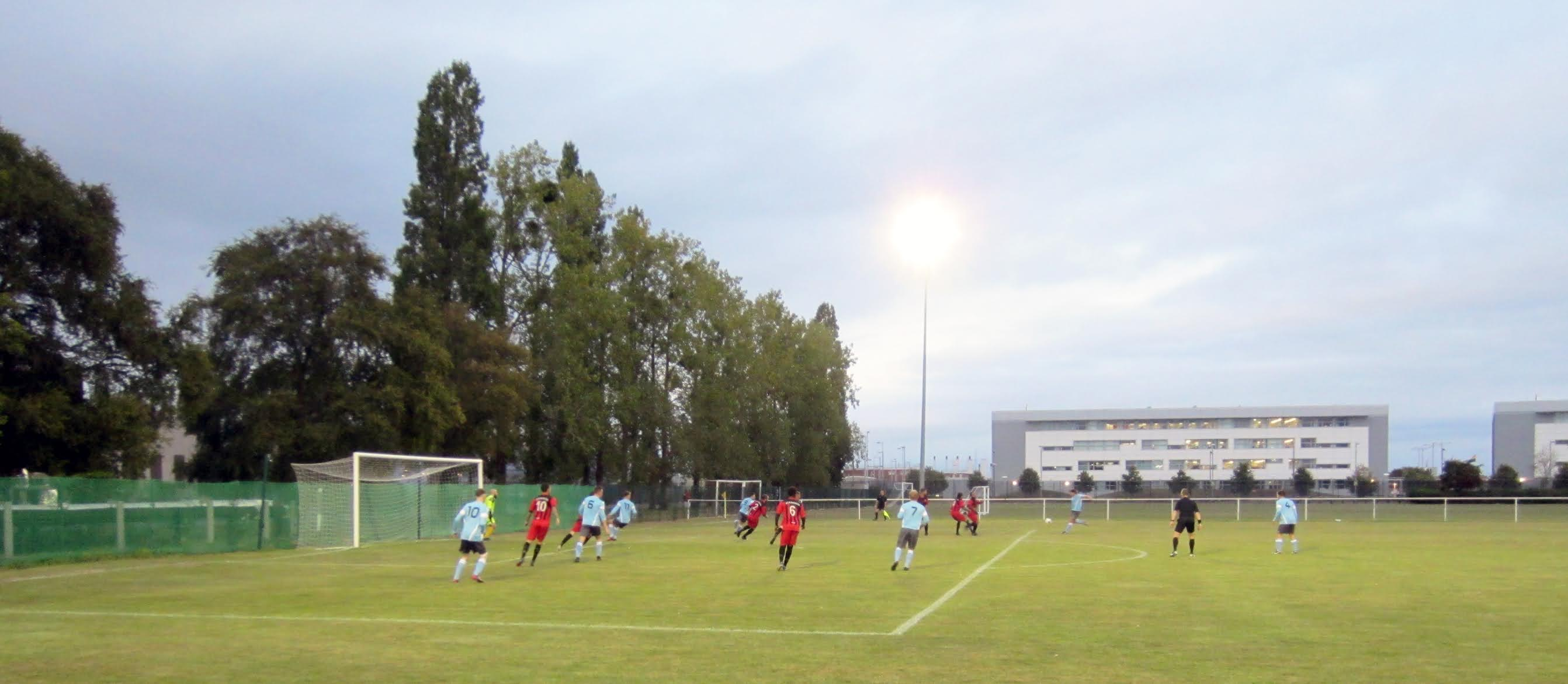 A Woodley United player takes a shot at Aldermaston Recreational Society
